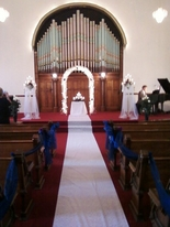 A white bridal runner, ready and waiting inside the historical wedding chapel, Richmond, Indiana