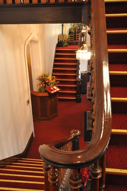 Double staircase in the foyer of The Olde North Chapel, Richmond, Indiana